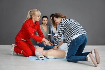 group of students performing cpr training